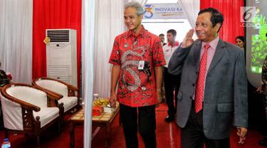Gubernur Jawa Tengah, Ganjar Pranowo didampingi Ketua Gerakan Suluh Kebangsaan, Mahfud MD menghadiri Dialog Kebangsaan di Stasiun Solo Balapan, Rabu (20/2). Dialog tersebut bertema 'Merawat Harmoni dan Persatuan'. (Liputan6.com/Johan Tallo)