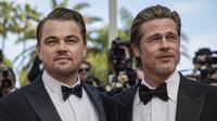 Brad Pitt dan Leonardo DiCaprio dalam pemutaran perdana Once Upon a Time in Hollywood di Festival Film Cannes, 21 Mei 2019. (Photo by Vianney Le Caer/Invision/AP)