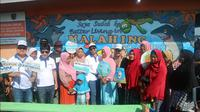 Menteri BUMN Rini Soemarno kunjungi Kampung apung Malahing (Foto:Liputan6.com/Bawono Y)