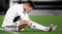 Kesedihan Cristiano Ronaldo setelah Juventus terhenti di perempat final Liga Champions 2018-2019. (AFP/Filippo Monteforte)