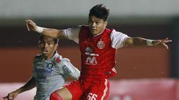 Alfath Fathier - Pemain bernomor punggung 66 ini pernah menimba ilmu di akademi Persib Bandung pada tahun 2013 hingga 2016. Bek sayap kelahiran Bandung itu tampil disiplin di sisi pertahanan Persija Jakarta. (Bola.com/M Iqbal Ichsan)