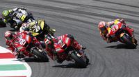 Danilo Petrucci (9) memenangkan balapan MotoGP Italia. (AP Photo/Antonio Calanni)