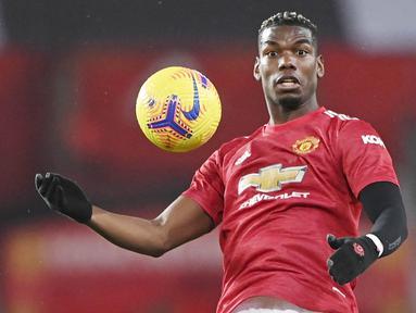 Andalan Manchester United, Paul Pogba belum juga mencapai kesepakatan dengan Setan Merah soal kelanjutan kontraknya yang tersisa akhir musim nanti. Jika tidak ada kesepakatan baru, Paul Pogba bisa saja pergi dengan gratis seperti 7 pendahulunya berikut. (Foto: AFP/Pool/Laurence Griffiths)