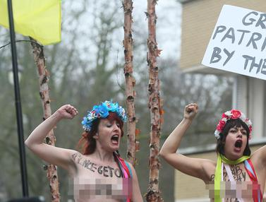20170221-Aktivis Femen Telanjang Dada Tolak Trump di Belgia-AFP Photo