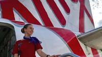 Pesawat Setop Terbang Akibat Corona Covid-19, Pramugari Beri Pesan Terakhir Mengharukan. (dok.Instagram @virginaustralia/https://www.instagram.com/p/B-DhNDmJpvU/Henry)