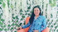 Mira Turang memilih mengabdi sebagai guru di Kabupaten Minahasa Selatan, Sulut.