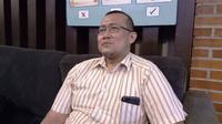 Husain Nurisman (45), penyintas kanker usus besar (kolorektal), yang kini sudah berkualitas hidupnya. (Liputan6.com/Fitri Haryanti Harsono)