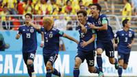 Jepang mencetak sejarah d Piala Dunia sebagai negara Asia pertama yang mampu mengalahkan tim Amerika Selatan setelah menang 2-1 atas Kolombia. (AFP/Jack Guez)