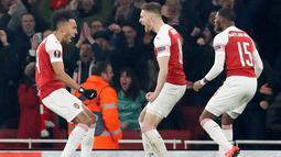 Selebrasi striker Arsenal Pierre-Emerick Aubameyang usai mencetak gol ke gawang Stade Rennes pada leg kedua babak 16 besar Liga Europa di Stadion Emirates, London, Inggris  (14/3). (REUTERS/David Klein)