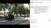 Seperti dilansir akun Instagram @fakta.indo, Jumat (4/10/2019), sebuah video memperlihatkan seorang pria berusaha menghindari razia dengan berputar arah di jalan menikung. (@fakta.indo)