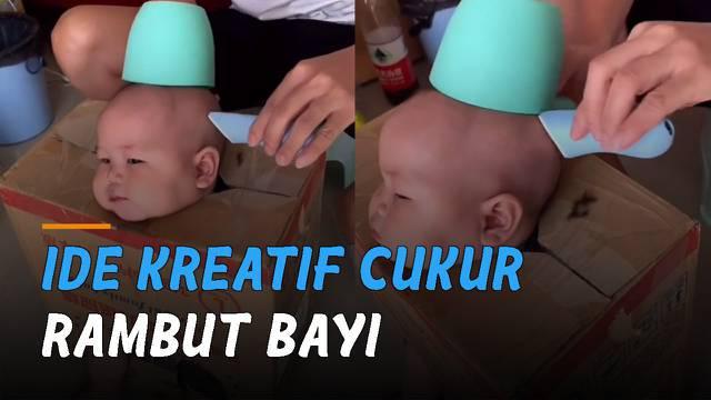 Aksi kreatif dan kocak dilakukan oleh seorang pria saat memotong rambut anaknya yang masih bayi.