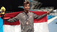 Triady Fauzi Sidiq mengaku gugup saat bersaing menghadapi peraih medali emas Olimpiade 2016, Joseph Schooling, pada SEA Games di National Aquatic Centre, Bukit Jalil, Senin (21/8/2017). (Liputan6.com/Cakrayuri Nuralam)
