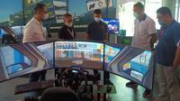 Pengurus NOC saat mengunjungi fasilitas balap digital di LPDUK Kemenpora (istimewa)