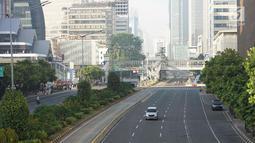 Kondisi lalu lintas di Jalan MH Thamrin, Jakarta, Rabu (5/6/2019). Banyaknya warga Ibu Kota yang mudik ke kampung halaman untuk merayakan Hari Raya Idul Fitri membuat jalan protokol terpantau lengang. (Liputan6.com/Immanuel Antonius)