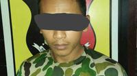 Dede (25) tersangka Marinir Gadungan. (Foto: Liputan6.com/Kodim Cilacap/Muhamad Ridlo)