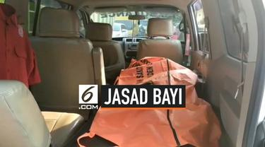Sesosok mayat bayi perempuan di dalam tas ditemukan warga Kampung Tlajung, RT 02/RW 13, Desa Tlajung Udik, Kecamatan Gunung Putri, Kabupaten Bogor, Jawa Barat.