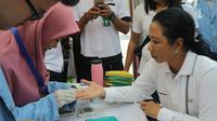 Menteri BUMN Rini Soemarno menghadiri serangkaian acara rangkaian HUT ke-21 Kementerian BUMN di Pekanbaru, Riau. Dok Kementerian BUMN