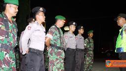 Citizen6, Kendal: Patroli gabungan antara pasukan Polres Kendal dan Kodim 0715/Kendal dipimpin oleh Kabag Operasi Kompol Heru Iriyanto. (Pengirim: Aryo Widianto)