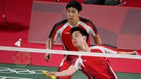 Ganda putra Indonesia Kevin Sanjaya Sukamuljo / Marcus Fernaldi Gideon pada Olimpiade Tokyo 2020. (AFP/Alexander Nemenov)