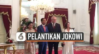 Presiden RI terpilih Joko Widodo sempat menerima kedatangan dari Perdana Menteri Australia dan Singapura jelang dilantik.
