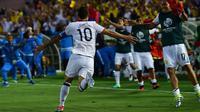 Selebrasi pemain Kolombia, James Rodriguez, setelah menjebol jala Paraguay pada pertandingan kedua Grup A Copa America, Rabu (8/6/2016). (AFP)