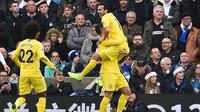 Winger Chelsea Pedro Rodriguez merayakan gol ke gawang Brighton & Hove Albion pada laga Liga Inggris di American Express Community Stadium, Minggu (16/12/2018). (AFP/Glyn Kirk)