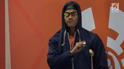 Perenang Indonesia, Jendi Pangabean bersiap tampil pada Asian Para Games cabang renang nomor 100 meter gaya punggung S9 di Stadion Aquatic, Jakarta, Kamis (11/10). (Bola.com/Vitalis Yogi Trisna)