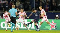 Pemain Paris Saint-Germain Lionel Messi (kedua kanan) melakukan tembakan saat melawan RB Leipzig pada pertandingan sepak bola Grup A Liga Champions di Stadion Parc des Princes, Paris, Prancis, Selasa (19/10/2021). Paris Saint-Germain (PSG) menang 3-2. (AP Photo/Francois Mori)
