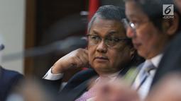 Gubernur Bank Indonesia (BI), Perry Warjiyo saat Rapat Dewan Gubernur di Jakarta, Kamis (21/2). BI kembali menahan suku bunga acuan BI 7-Days Reverse Repo Rate (BI7RRR) di angka 6 persen. (Liputan6.com/Angga Yuniar)