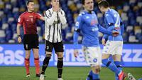 Megabintang Juventus, Cristiano Ronaldo, tak mampu menghindarkan timnya dari kekalahan 0-1 kontra Napoli pada laga pekan ke-22 Serie A di Stadio Diego Armando Maradona, Minggu (14/2/2021) dini hari WIB. (AFP/Filippo Monteforte)