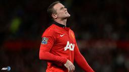 Ekspresi Wayne Rooney pada pertandingan Liga Inggris antara Manchester United melawan Chelsea di Stadion Old Trafford, Manchester Selasa 27 Agustus 2013. (AFP/Andrew Yates)