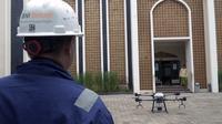 PT Bank Negara Indonesia (Persero) Tbk menerbangkan drone untuk menyemprotkan disinfektan.