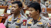 Kapolri Jenderal Polisi Idham Azis (kiri) dan Wakapolri Komjen Ari Dono saat rapat kerja perdana dengan Komisi III DPR di Kompleks Parlemen, Jakarta, Rabu (20/11/2019). Rapat membahas anggaran, pengawasan, dan isu-isu terkini di Indonesia termasuk bom di Polrestabes Medan. (Liputan6.com/JohanTallo)