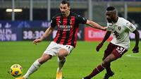 AC Milan meraih kemenangan 5-4 atas Torino lewat drama adu penalti, pada laga 16 besar Coppa Italia di San Siro, Rabu (13/1/2021) dini hari WIB. Hasil tersebut membuat Milan lolos ke perempat final. (AFP/Miguel Medina)