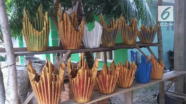 Menyulap Handuk Bekas Jadi Pot Bunga Unik Bernilai Jual - Regional ... a6836b4dd5
