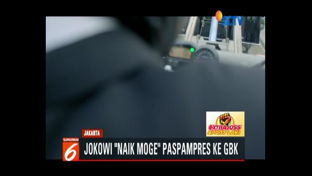 Presiden Jokowi terpaksa naik moge karena terjebak kemacetan akibat banyaknya pendukung Indonesia yang hendak menyaksikan pembukaan Asian Games 2018.
