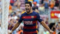 Luis Suarez melakukan selebrasi usai bobol gawang Las Palmas (Reuters)