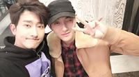 Perseteruannya dengan SM Entertainment tidak menghalangi Tao untuk tetap menjalin keakraban dengan Zhoumi [foto: Soompi]