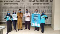 Perum DAMRI (Djawatan Angkoetan Motor Republik Indonesia) Purworejo dab BUMN Purworejo berkolaborasi bersama para karyawan milenial BUMN  terjun mensosialisasikan pentingnya pencegahan penyeberan Corona Covid-19 sejak Senin (19/10/2020) hingga Jumat (23/10/2020). (Liputan6.com/Tyas Titi Kinapti)