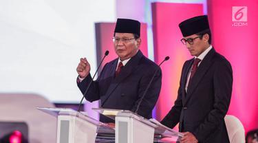 Ekspresi Prabowo - Sandiaga Uno Saat Debat Pilpres 2019