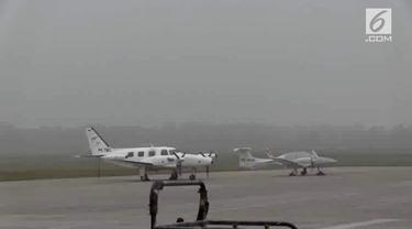 kota Palembang Minggu pagi tadi dilanda kabut tebal dengan jarak pandang hanya 500 meter. Akibatnya penerbangan pesawat di Bandara Interansional Sultan Mahmud Badaruddin Dua (SMB II) Palembang terganggu.