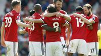 Michael Carrick merayakan gol Marcus Rashford saat MU kalahkan Watford (Martin Rickett/PA via AP)