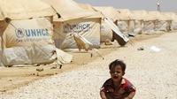 Seorang bocah tengah menangis di kamp pengungsi Suriah (Jordan Business Magazine)