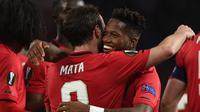 Ekspresi Fred setelah mencetak gol untuk Manchester United pada laga Liga Europa kontra Club Brugge di Old Trafford, Jumat (28/2/2020) dini hari WIB. (AFP/Oli Scarff)