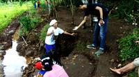 Warga lereng Gunung Tumpeng di wilayah Semanu, Kabupaten Gunungkidul, DIY, dikejutkan dengan penemuan mata air di lahan gersang. (Liputan6.com/Yanuar H)