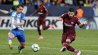 Luis Suarez menyumbangkan satu gol saat Barcelona menang 2-0 atas Malaga pada laga pekan ke-28 La Liga Spanyol, di Estadio La Rosaleda, Sabtu (10/3/2018) waktu setempat. (AP Photo/M.Pozo)