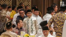 Ketum PKB Muhaimin Iskandar tiba untuk menghadiri acara Buka Puasa Bersama Partai Golkar, di Jakarta, Minggu (19/5/2019). Kegiatan tersebut mengangkat tema Menjemput Kemenangan Ramadan. (Liputan6.com/Faizal Fanani)