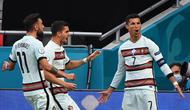 Striker Portugal, Cristiano Ronaldo merayakan golnya ke gawang Hungaria dalam laga perdana Grup F Euro 2020, Selasa (15/6/2021). (Attila KISBENEDEK / POOL / AFP)