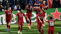 Pemain Liverpool merayakan gol Divock Origi ke gawang Tottenham Hotspur pada final Liga Champions 2018-2019 di Stadion Wanda Metropolitano, Madrid, Minggu (2/6/2019) dini hari WIB. (AFP/Oscar Del Pozo)
