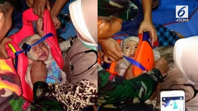 Bayi  berusia 7 bulan selamat dari tragedi tenggelamnya KM Lestari Maju usai sang ibu yang tewas mengikatkannya pada pelampung.